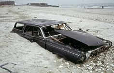 Welcome to New York, 1973 style! Half buried early 1960s Dodge ...