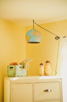 This Hanging Earth Light is the perfect decor idea for a travel themed nursery or space!
