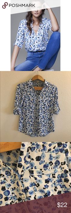 Express Blue Floral Portofino Shirt Size XS blue and white floral Portofino shirt by Express. No flaws, only worn a few times. Pockets on the front. Sleeves can be worn full length or cuffed. Items stored in a smoke free, pet free environment. I ship daily, excluding Sundays and holidays. Open to offers; bundles discounted! Express Tops Button Down Shirts