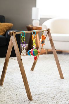 This wooden baby gym boasts a minimalist design that isnt the usual eyesore associated with baby gear. If you are anything like us, you dont