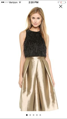 This tibi fringe crop top over a high waist flared skirt... Black tie perfection!