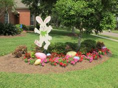 I am loving the bunny with the big Easter eggs in the flower bed.  SO CUTE!
