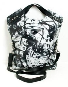 Awesome fold-over from a new line of handbags by Moth and Crow