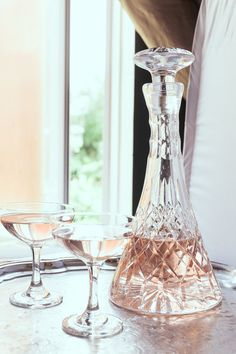 Celebrate your perfect moment with this gorgeous set of 2 faceted stem champagne coupes. Made in the 1960s, add some real vintage glam to your