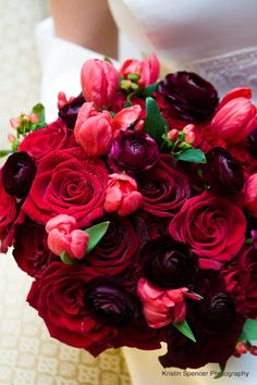Shades of red bridal bouquet. Roses,tulips,ranunculus,hypericum berry! Perfect winter combo...