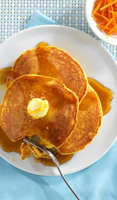 Orange Delight Pancakes - Everyone will ooh and ahh over these pancakes made with carrots and topped with orange butter.