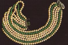 "The Cannes Film Festival piece also went to the Houston, Cuban, and Sundance festivals. Here are the pearls kisssing in opera length. It is posted as a twisted pearl crush, may also be worn with the pearls split and as opera length, the 2.5"" 18kt gold clasp /double saftey displays the Japanese Imperial Dragon and becomes a medallion or pendant, or worn as a crush the clasp at 3:00 or 9:00 sets off the Malachite and large Akoyo, Japanese for nearly round to round pearls."