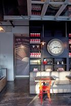 The clock slides up to reveal a hidden tv alcove