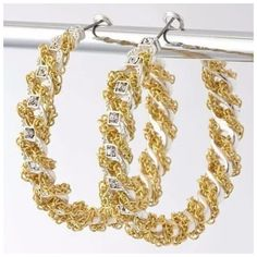 """D29 Chain Wrapped Silver Gold Crystal Hoop Earring ‼️PRICE FIRM‼️    Hoop Earrings  Retail $44  STUNNING PAIR OF EARRINGS. Silver color metal wrapped with gold color chains.  Adorned with clear crystals.  Lever back closure.  Great for a formal event or as everyday earrings. Approximately 6.5"""" around & hangs down approximately 2"""".  Please check my closet for many more items including scarves, shoes, designer clothing, handbags & much more Boutique Jewelry Earrings"""