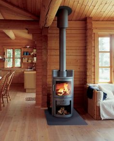 Wood burning stove with large window. Modern Wooden House, Timber House, Stove Fireplace, Fireplace Design, Modern Wood Burning Stoves, Wood Stoves, Slate Hearth, Treehouse Cabins, Small Cottages