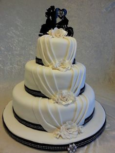 Motorcycle black and white classic wedding cake.                                                                                                                                                                                 More