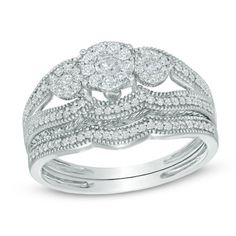 Intricate milgrain detailing graces the edges, giving the ring a vintage look and feel.