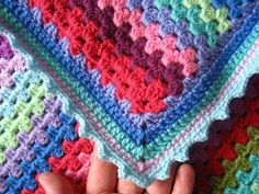 After the granny clusters, I worked two rows of treble crochet, followed by a thin row of pink double crochet. Then with the light blue I wo...