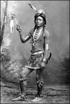 A Shoshone man in Sun Dance attire. Photo taken between 1884 and 1885.