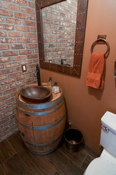 This installation has multiple Premier Copper Products Items.  Our new wine barrel vanity is featured, accessorized with a copper mirror, towel ring, copper trashcan and switch plate cover.  Beautiful!!  http://premiercopperproducts.com/products/category/copper-vanities/wine-barrel-vanity-package-with-17-oval-skirted-vessel-copper-sink-faucet-natural-finish/