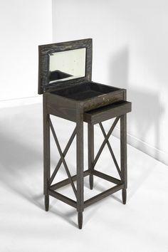 """Marcel Charles COARD (1889-1974) Table à ouvrage en chêne teinté noir patiné à la céruse ouvrant en façade par un tiroir en ceinture et un abattant en partie haute sur un casier à miroir. Piètement d'angle en gaine fuselée terminé par des olives.  Dimensions H : 72 cm (28,3"""") - plateau : 40 cm (15,7"""")x 28 cm (11"""")"""