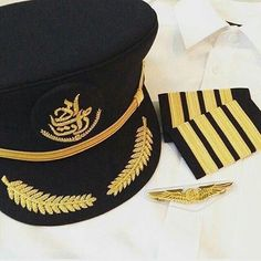 Image result for emirates pilot uniform