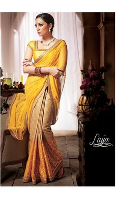 Look beautiful in every function, party event or any occasion with this elegant Yellow designer party wear saree. Made from Georgette,Cotton and the saree gives you different feeling with this eye-catchy design. Saree comes with matching unstitched blouse piece that can be custom stitched for upto bust size of 42 inches.