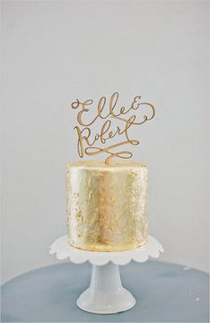gold wedding cake with cool cake topper. See more fabulous cakes here  http://www.weddingchicks.com/2013/08/29/cake-toppers/