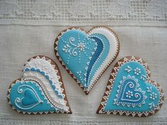 Blue and white heart cookies -- The cookies on this site will blow your mind! Valentine's Day!