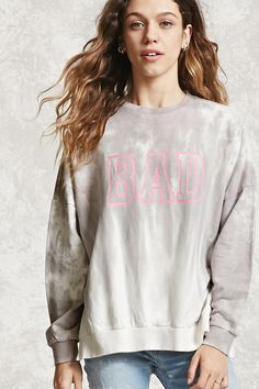 b61222ebf76c2 An oversized French terry knit sweatshirt featuring a