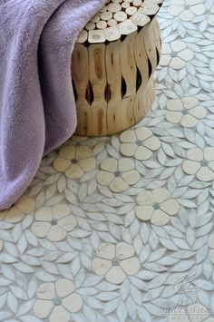 Jacqueline, a natural stone waterjet mosaic shown in tumbled Bianco Antico, Blue Macauba, and Carrara, is part of the Silk Road Collection by Sara Baldwin for New Ravenna Mosaics.  Copyright New Ravenna Mosaics 2009