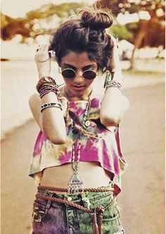 Distressed jean shorts + multi-colored high rise top + hippie glasses + tons of bracelets!!