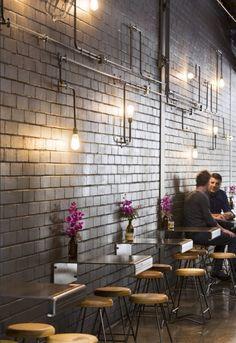 lights + bricks + wall art + industrial + cafe