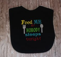 """Baby Bib Design-Funny Bib Saying-Embroidered Bib Saying-Embroidery-""""Feed Me or Nobody Sleeps Tonight"""" Machine Embroidery This is a design that you can stitch out with an embroidery machine. This is an INSTANT DOWNLOAD, this will be in a zipped format……. formats that I offer are: PES DST EXP HUS VIP XXX JEF This is cute for a baby bib…….(bib not included) for design only…. Feed me or nobody sleeps tonight…designed it in bold bright colors…….you will get 2 with different color selections one…"""