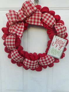 This is a handcrafted one of a kind wreath that Ive created using a 14 wreath form and generously looping a red burlap around it resulting in the final dimensions being approximately Ive then woven through a pretty red/white plaid ribbon and finished i Spode Christmas Tree, Burlap Christmas, Christmas Crafts, Christmas Decorations, Christmas Ornaments, Xmas, Christmas Mesh Wreaths, Christmas String Lights, Diy Wreath