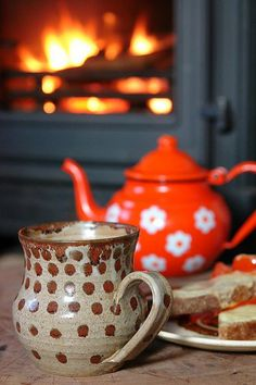 thaxted:  dreamsofsomewhereelse:  Tea  toast by the fire by H is for Home on Flickr.  Some cozy tea imagery with a beautiful ceramic mug to get this week kicked off properly.
