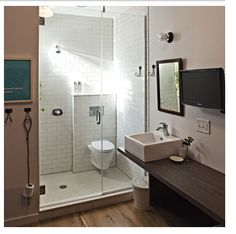 love this clean lined, subway tiled, integrated toilet & shower room at longman & eagle inn in chicago. room #13