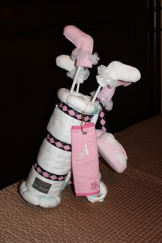 Golf Bag Diaper Cake. How precious! @Marsha Serigny Dupont - I wish I would have seen this before Benny made his entrance in the world! His pawpaw would have LOVED this..in blue of course! =]