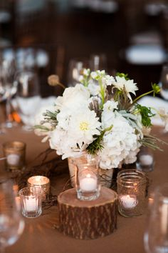 rustic centerpiece. uses tree trunks like you were thinking! cute :)