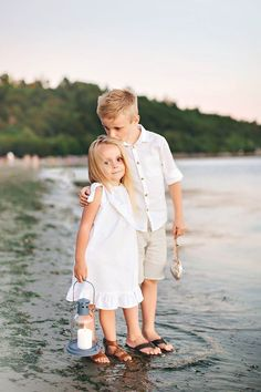 Summer family photo shoot, beach family photos, summer pictures, summer family photos, summer family photo ideas, beach themed ideas. Sand, nautical, water, big brother, little sister, brother, sister, love, sibling, beach, family, photography.