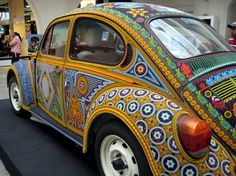 VW Beetle decorated with seed beads. It took 7 months to complete.