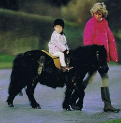 1987-12-31 Diana takes Harry for a ride on his Shetland pony in Sandringham