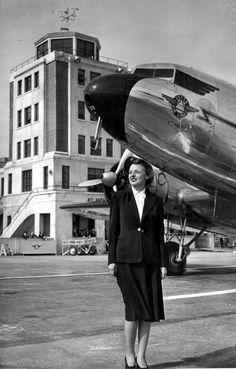 Dec. 1940 - Atlanta, Ga.: Delta Air Lines Chief Stewardess Laura Wizark stands before one of the fleet's planes. By 1940, Delta had been servicing Atlanta for 10 years.