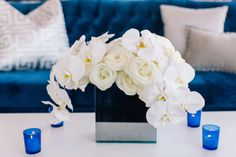 Dark Blue Couch with White Pillows and White Flowers  Photography: Vue Photography Read More: http://www.insideweddings.com/weddings/detroit-lions-qb-matthew-staffords-southern-style-rehearsal-dinner/739/