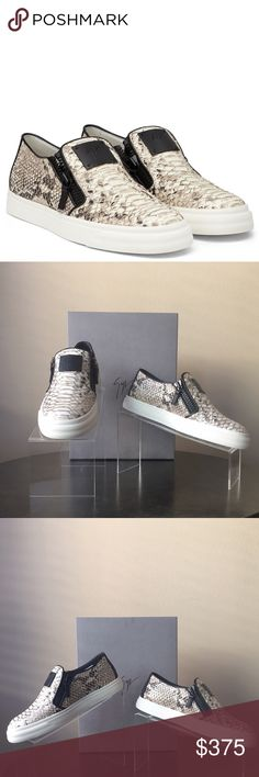 Authentic Giuseppe Zanotti Snake Embossed Sneaker Silvery metallic trim traces the embossed scales of a snake-patterned slip-on featuring double exposed zippers and a classic white cupsole. New. Never Worn. Removable insole. Leather upper and lining/synthetic sole. Giuseppe Zanotti Shoes Sneakers