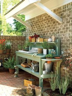 A potting bench with an outdoor sink keeps gardening projects organized in this Senoia, Georgia courtyard. (Photo: Tria Giovan)