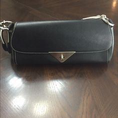 Black Handbag Small sized black handbag. Brand is Prada but can not verify authenticity nor do I actually believe it is authentic.  It's never been used so it has no marks or flaws.  Is black with silver hardware.  Measurements are 11 1/2 x 5 x 2. Bags Clutches & Wristlets