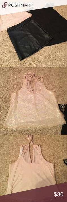 Sequined top, diamond top, faux leather skirt Charlotte Russe bundle! Faux leather skirt NWT. note in the picture does have marks on the back from the hanger. Not really noticeable with a shirt on. Two NWOT shirts one is an halter with sequin detail (short but not quite a crop top bought to put w the skirt looks cute together) and diamond detail sheer shirt with cute knot detail in the back. You get all three with purchase! Both look great with the skirt! Charlotte Russe Tops