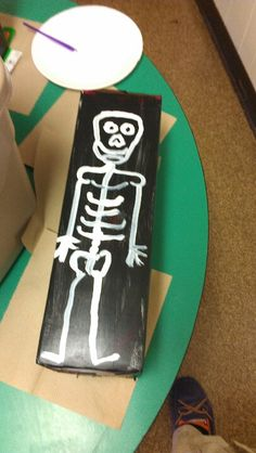Skeleton puppet made out of pop case.