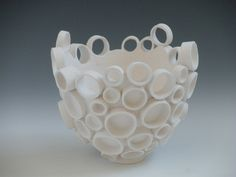 Katherine Dube at Echo Ceramics  Hmm I think I can recreate this with paper. Magazine pages maybe.