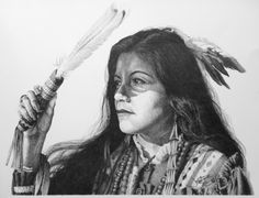 """This is a photo of a pencil portrait done for an Indian Festival, back in the mid-90's. The model is Ahnawake Clinch who, I beleive is Eastern-Band Cherokee, and had a small role in """"The Last of the Mohicans"""". I have poster prints available.. Original Drawing"""