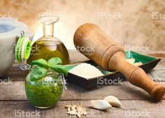 pesto sauce, raw ingredients and pestle with mortar foto stock royalty-free