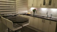 Example of a kitchen reno. We only changed the tiles and chose to have granite counter and breakfast corner