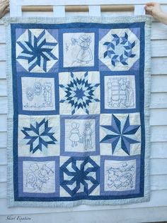 Baby boy quilt with embroidery and quilted stars.  A great quilt for someone looking to improve their quilting skills.