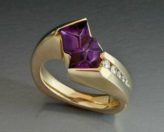 Gold ring with Amethyst Glyptic Illusion and diamonds